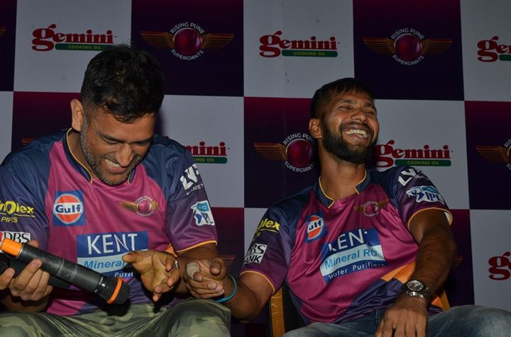 Sharing a light moment at the event.